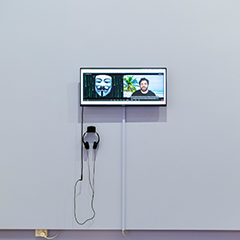 Part of the artwork showing a screen with artist Daniel McKewen in conversation with Anonymous